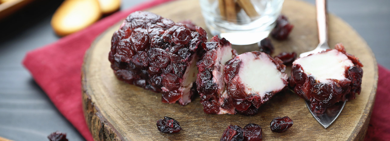 Sliced cranberry cheese log.